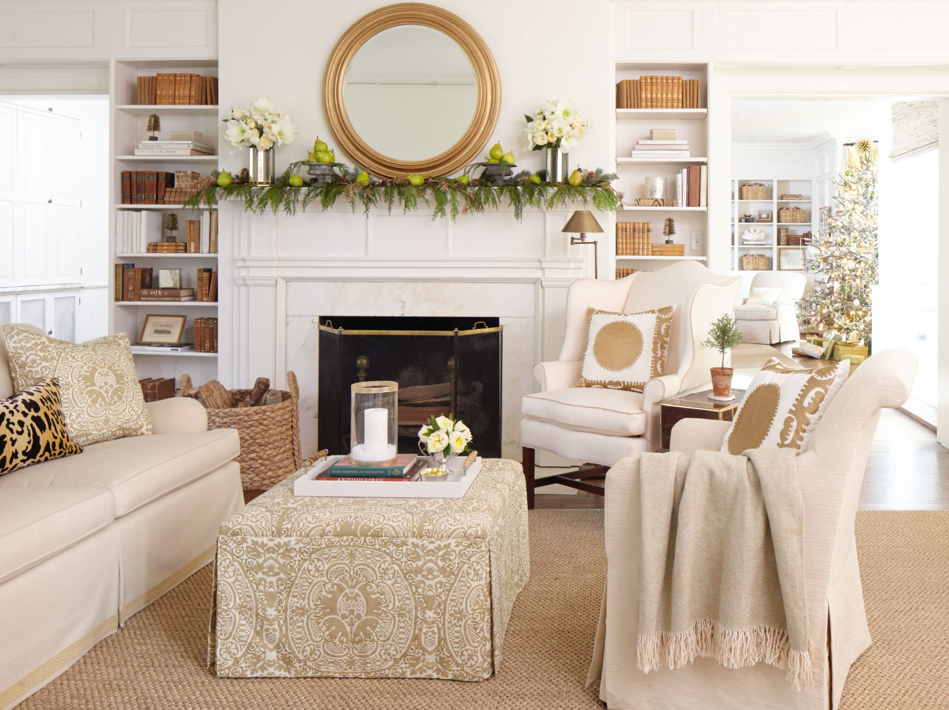 in this gorgeous neutral living room christmas decorations are kept minimal atop the mantel a green garland dotted with pears is anchored on both ends by - Neutral Christmas Decor