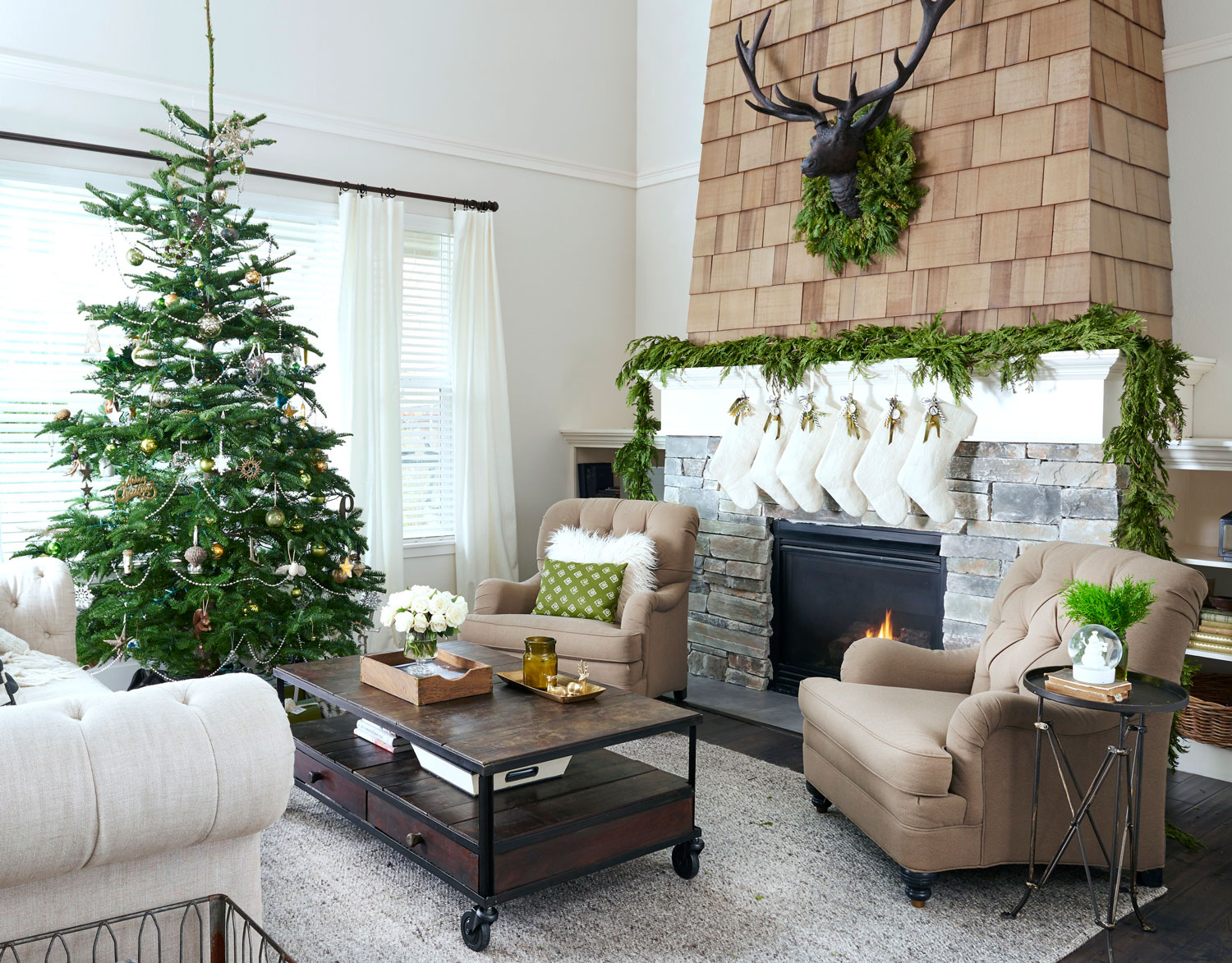 in a neutral living room a verdant garland wreath and tree provide a lively jolt of color the unadorned garland and wreath maintain the simplicity of - Rustic Christmas Decor
