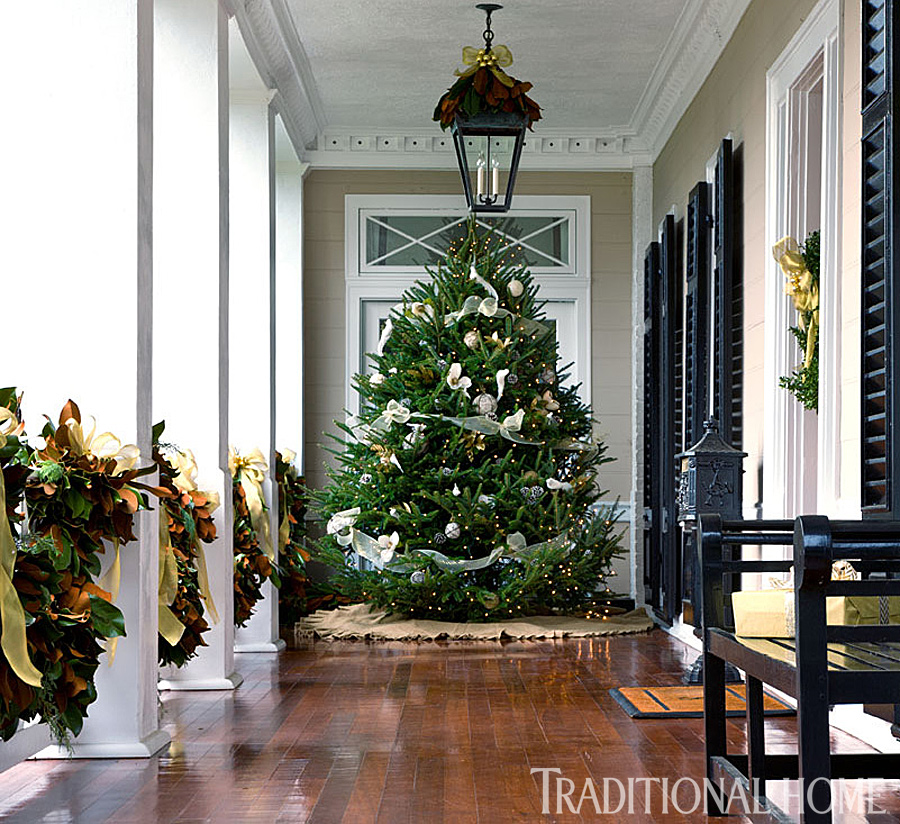 nothing says welcome like a christmas tree on the entry veranda soft teal ribbon pairs with a ruffled burlap skirt to complete the showstopping focal