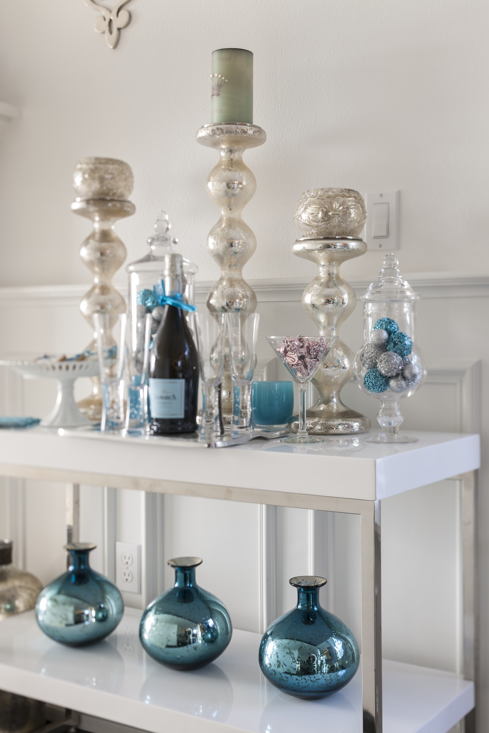 A Sideboard In The Living Room Serves As Bar Decked Out Plenty Of Gleaming Holiday Accoutrements All Blue White And Silver Course