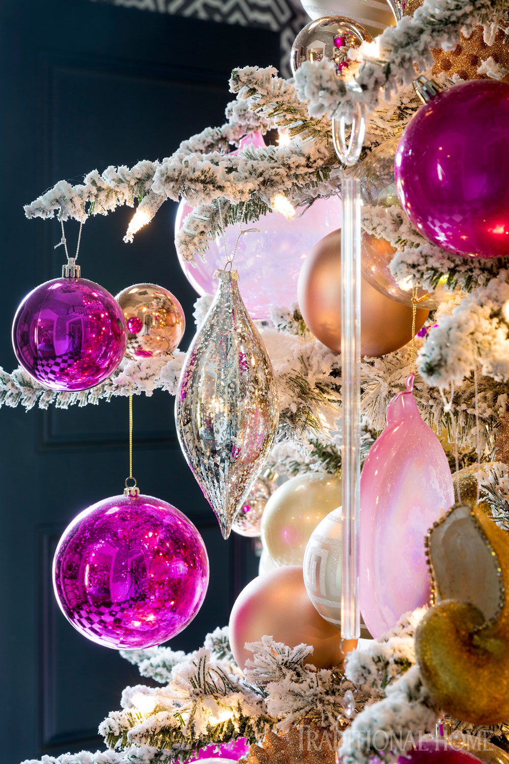 long slender icicles blend with mercury glass ornaments and glass balls in varying shades of pink ivory and champagne