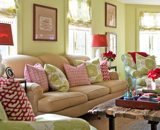 red and green living room. The soft apple green on the walls  chairs and pillow fabric is countered by bold shots of red in this window filled living room Classic Red Green Traditional Home