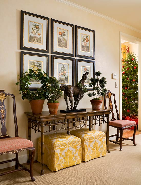 Colorful christmas in a colonial traditional home for Traditional foyer decorating ideas