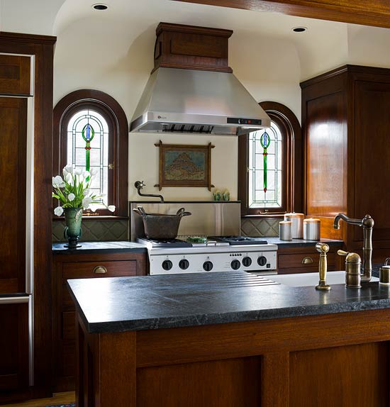 Custom Built By The Designer And His Dad, These Mahogany Kitchen Cabinets  Feature Full Inset Doors And Drawers And Brass Bin Pulls.