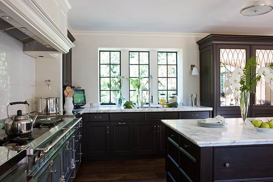 White Kitchen With Dark Cabinetry Ebonized Walnut Cabinets And Plaster Panels On The Range Hood Help Give This 1920s A Beautiful