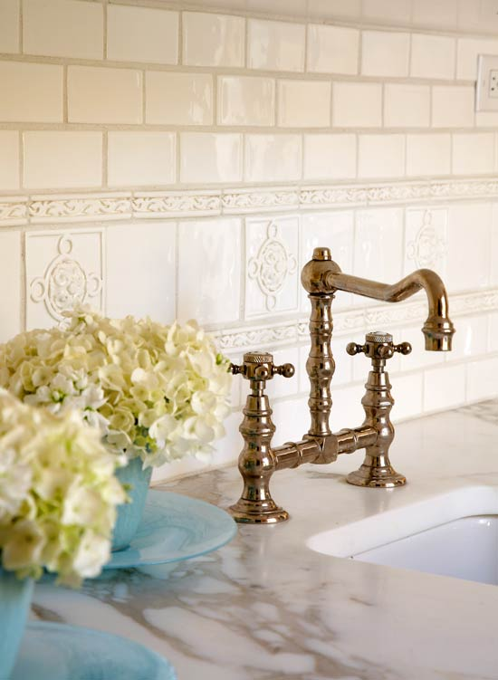 A Vintage Style Faucet And Subtle White On Tile Backsplash Dress Up This Section Of The Butler S Pantry Above Bas Relief Liner Tiles