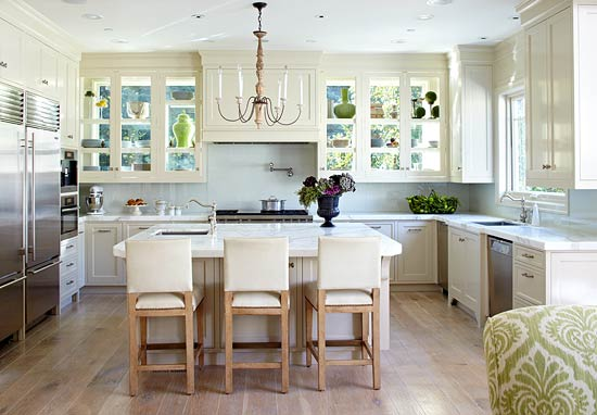 White Kitchens luxury kitchen with white glass face cabinets carrara marble counter island and two chandeliers Windows Form The Back Walls Of The Glass Doored Cabinets Allowing Light To Pour In And Illuminate The Simple White Kitchen Calacatta Marble Counters And A