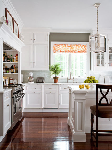 Delightful Opting For Refined And Simple, This Kitchen Is Outfitted With Classic White  Cabinets And Countertops Crafted From Honed Statuary Marble With Random  Gray ...