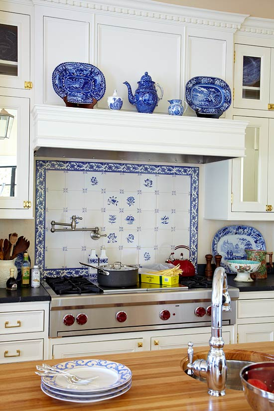 Inspired By A Collection Of Antique Blue And White Transferware This Focal Point Installation Showcases Delft Tiles With Coordinating Accent Border