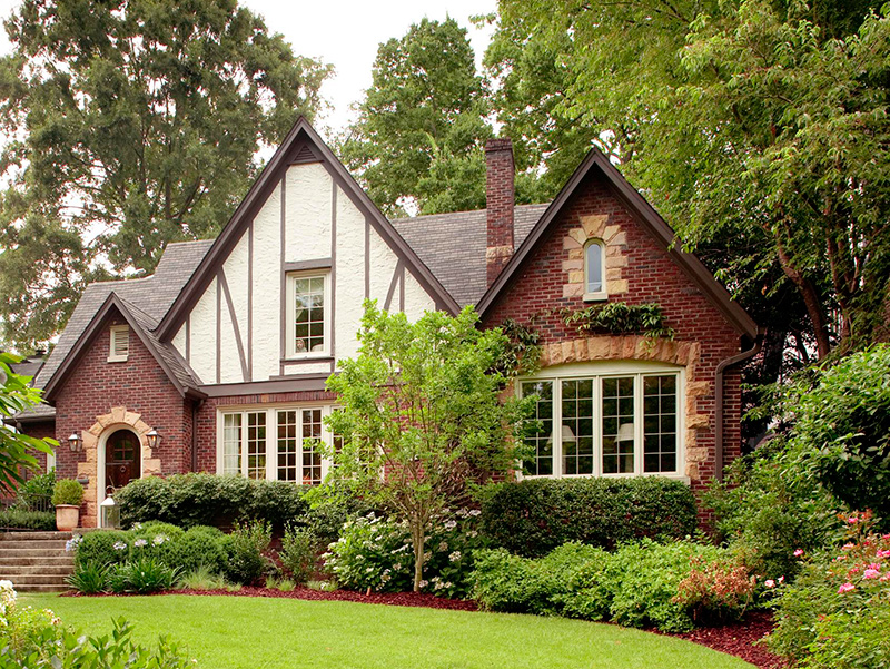 Get the look tudor style traditional home for Tudor house plans with photos