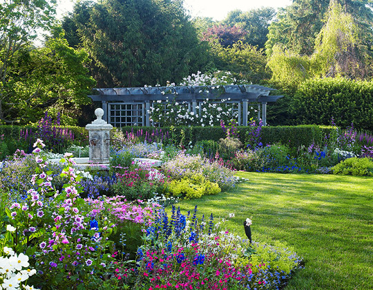 English style garden in the hamptons traditional home for Classic house with flower garden