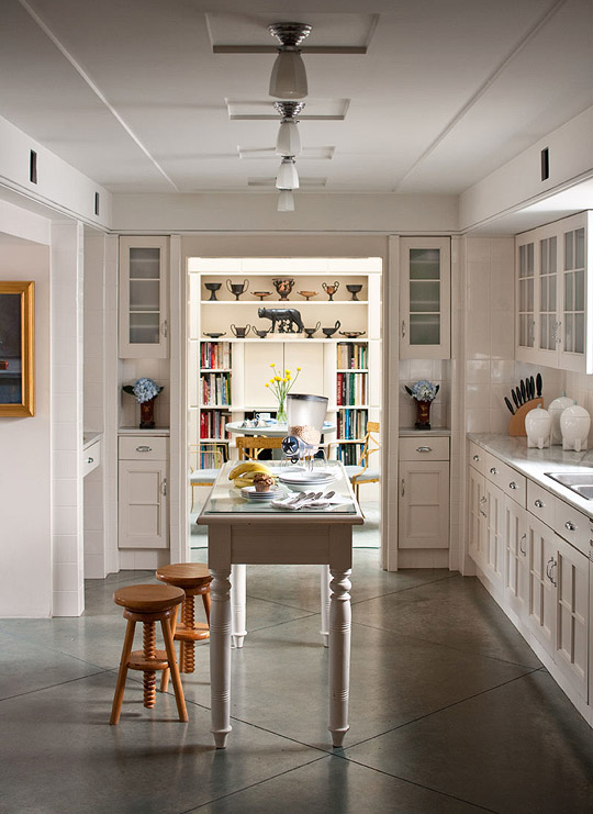 + ENLARGE. White Kitchen with Concrete Floor