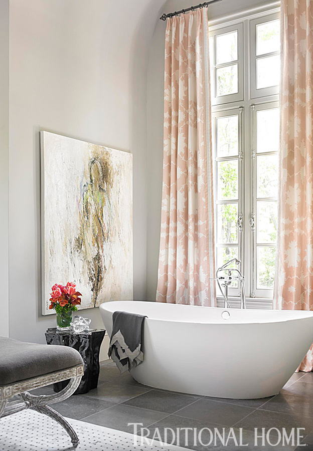 Holly Irwin painting in a beautiful bathroom in Traditional Home magazine.