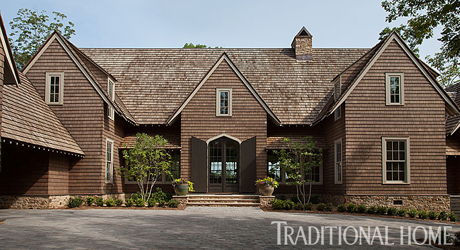 Gracious lakeside home traditional home for Traditional home builders