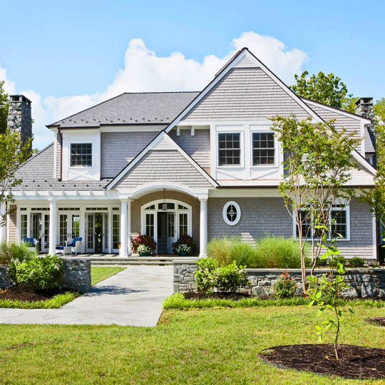 All white and blue delight traditional home for Classic new england home designs