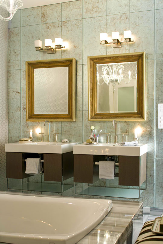 A Pair Of Vanities From Kohler Seem Suspended Against A Wall Of Silver Leaf  Glass Tiles In This New York Beach House Bath Designed By Eric Cohler.