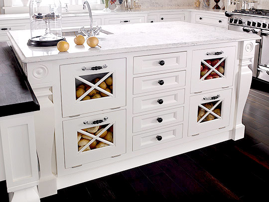 Wood Mode Fine Custom Cabinetryu0027s Southhampton Collection Features A  Furniture Style Island With Bin Storage.