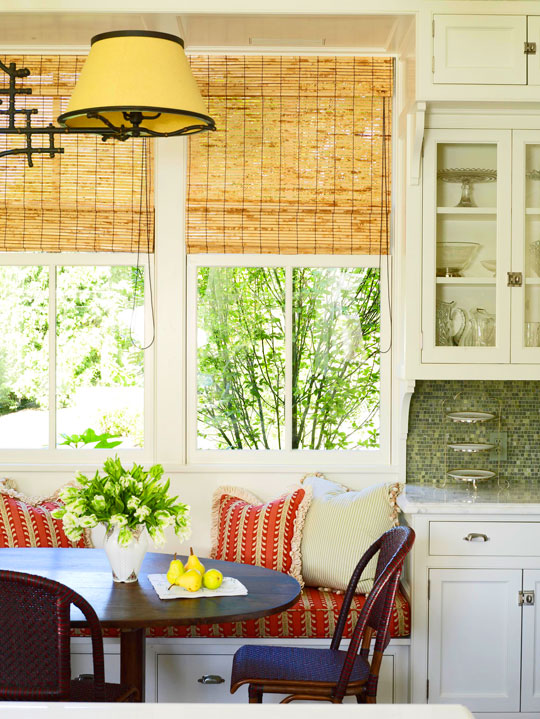 this kitchen banquette not only offers a cozy place to eat breakfast but also a wonderful view to the outdoors