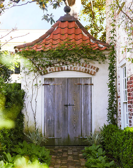 Gorgeous formal charleston garden traditional home for Traditional garden buildings