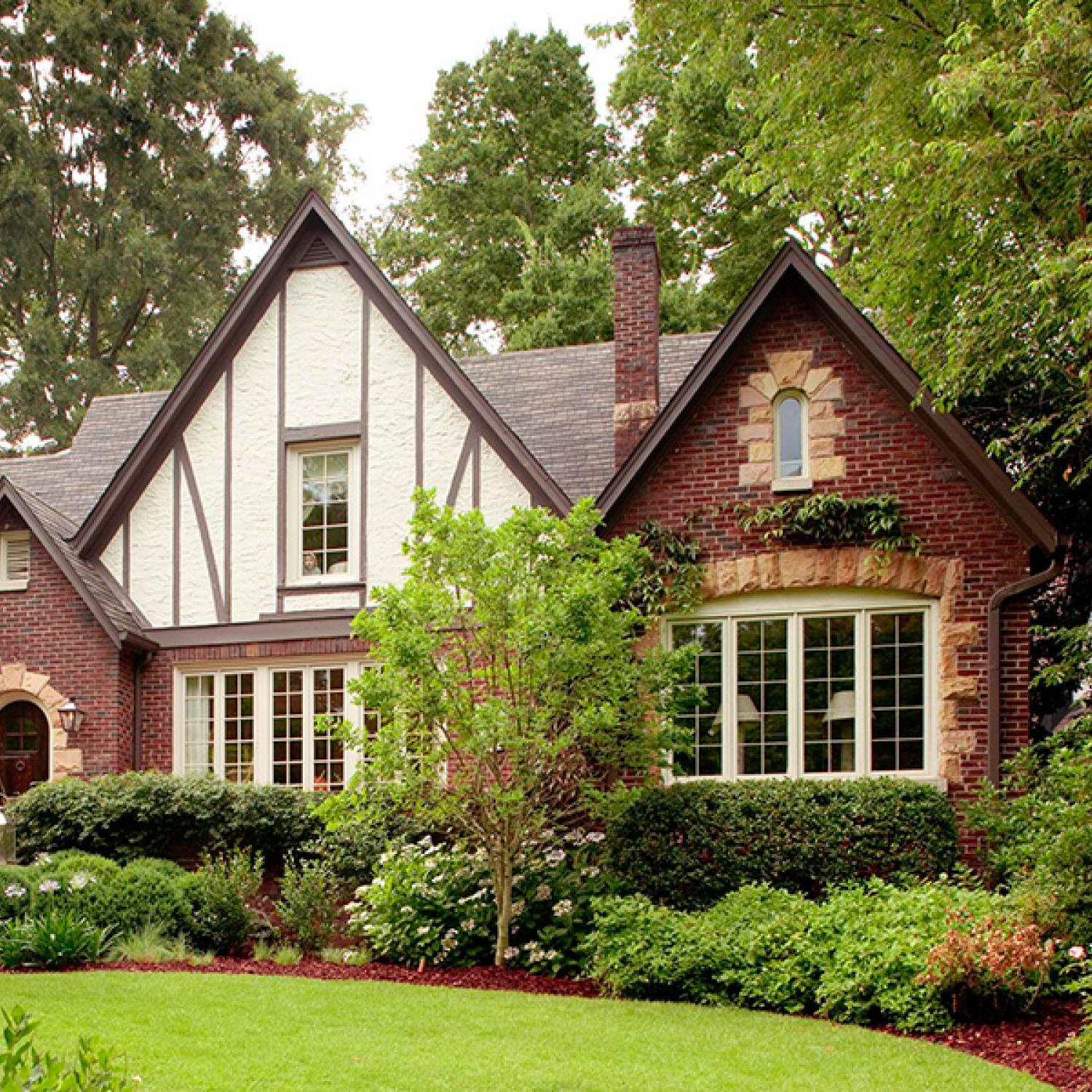 Get the look tudor style traditional home for Traditional home exterior