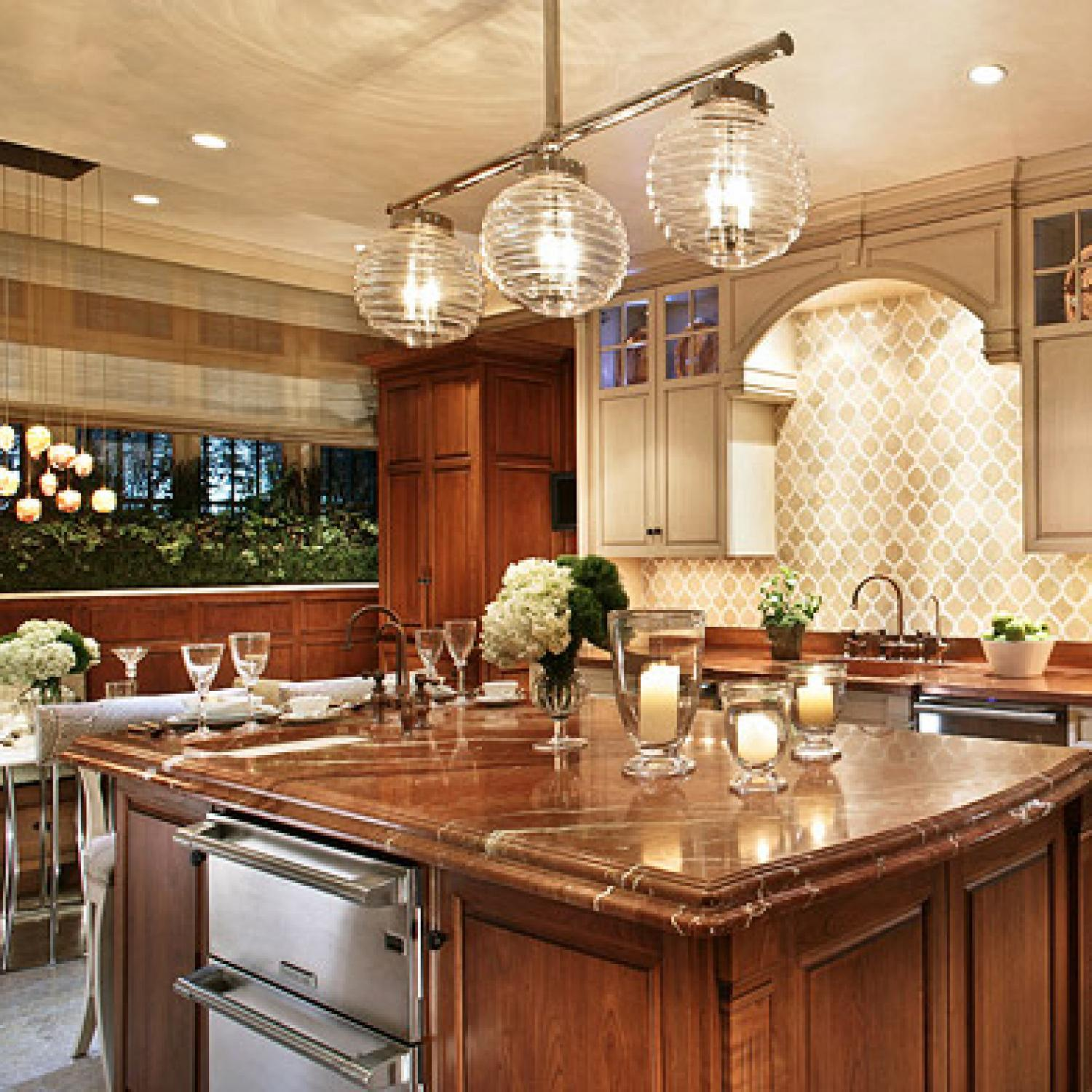 Welcoming intimate showhouse kitchen traditional home for Tuscan style kitchen lighting