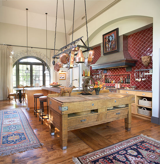 Adding Both Design Interest And Function An Antique French Butcher Block Table Doubles As Island In A Kitchen Furnished With Vintage