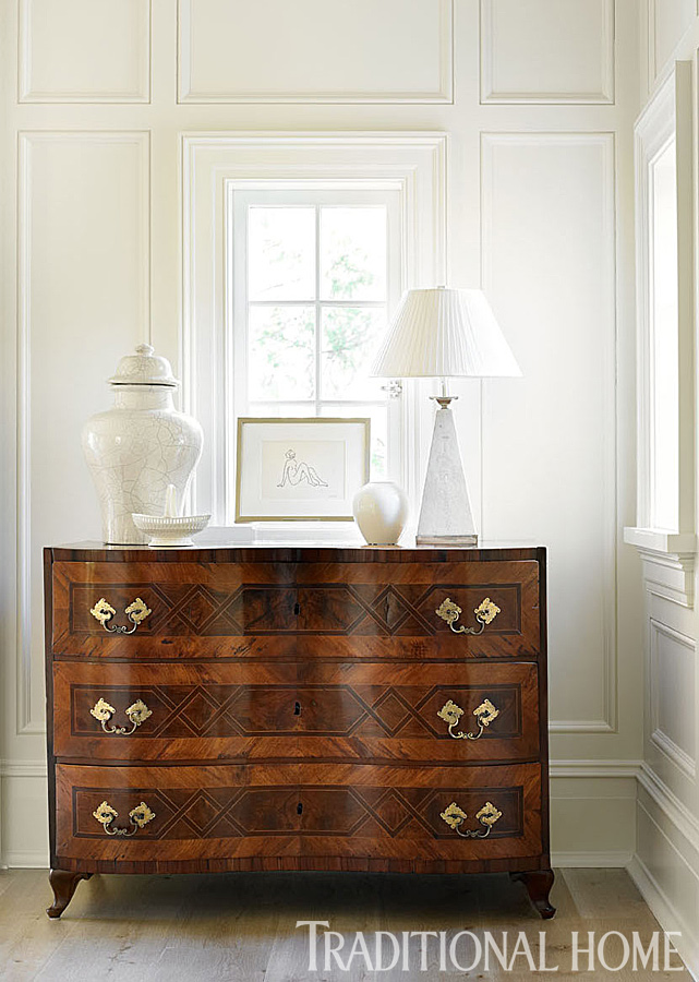 Bedroom decor in a classic bedroom with interior design by Phoebe Howard. An antique chest of drawers in the master bedroom lends weight to the room's airy palette. #bedroom #furniture #antique #chest