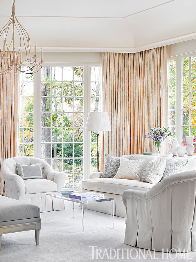 Interior design ideas photo gallery featuring this bedroom sitting area with design by Phoebe Howard. The embroidered tapestry fabric from Schumacher makes the bedroom feel like a lacy cocoon. Dressmaker details on the tufted chairs create romantic appeal in the master sitting area. #livingroomdecor #interiordesign #sittingroom #classic #traditional #pastels