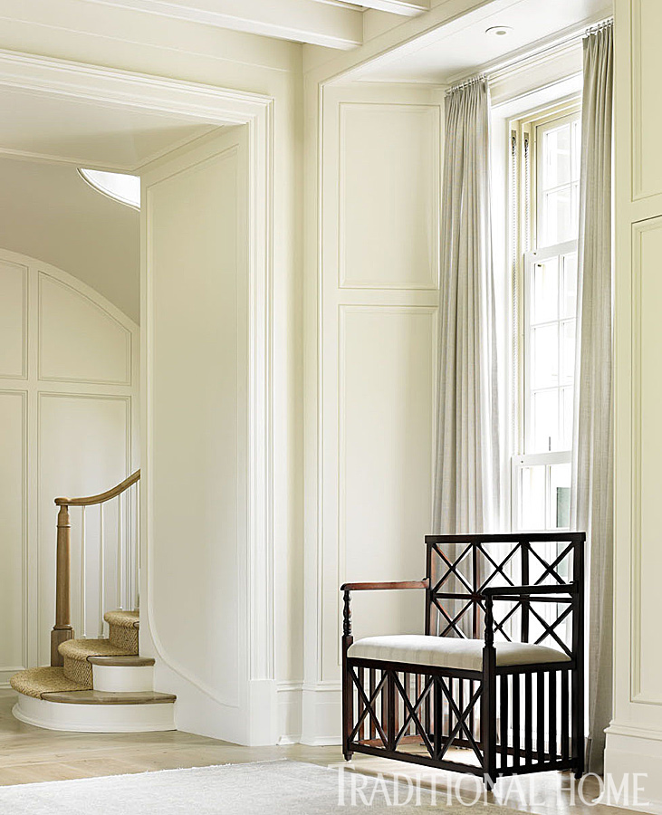 Interior design inspiration from Phoebe Howard. A sculptural bench by Michael S Smith stands out against the white backdrop in the entry. #interiordesign #entry #traditional #classic #whitedecor