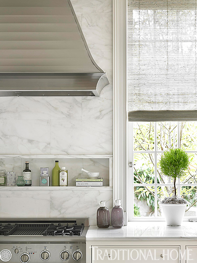 Classic kitchen with design by Phoebe Howard. Honed Calacatta Regina marble on the backsplash offers a subtle variation to the polished marble countertops. #kitchendesign #thermador #calacatta #traditional