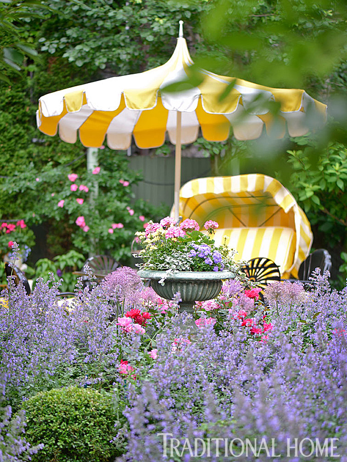 A yellow chaise longue on the patio brings a splash of sunny yellow to the colorful scene.