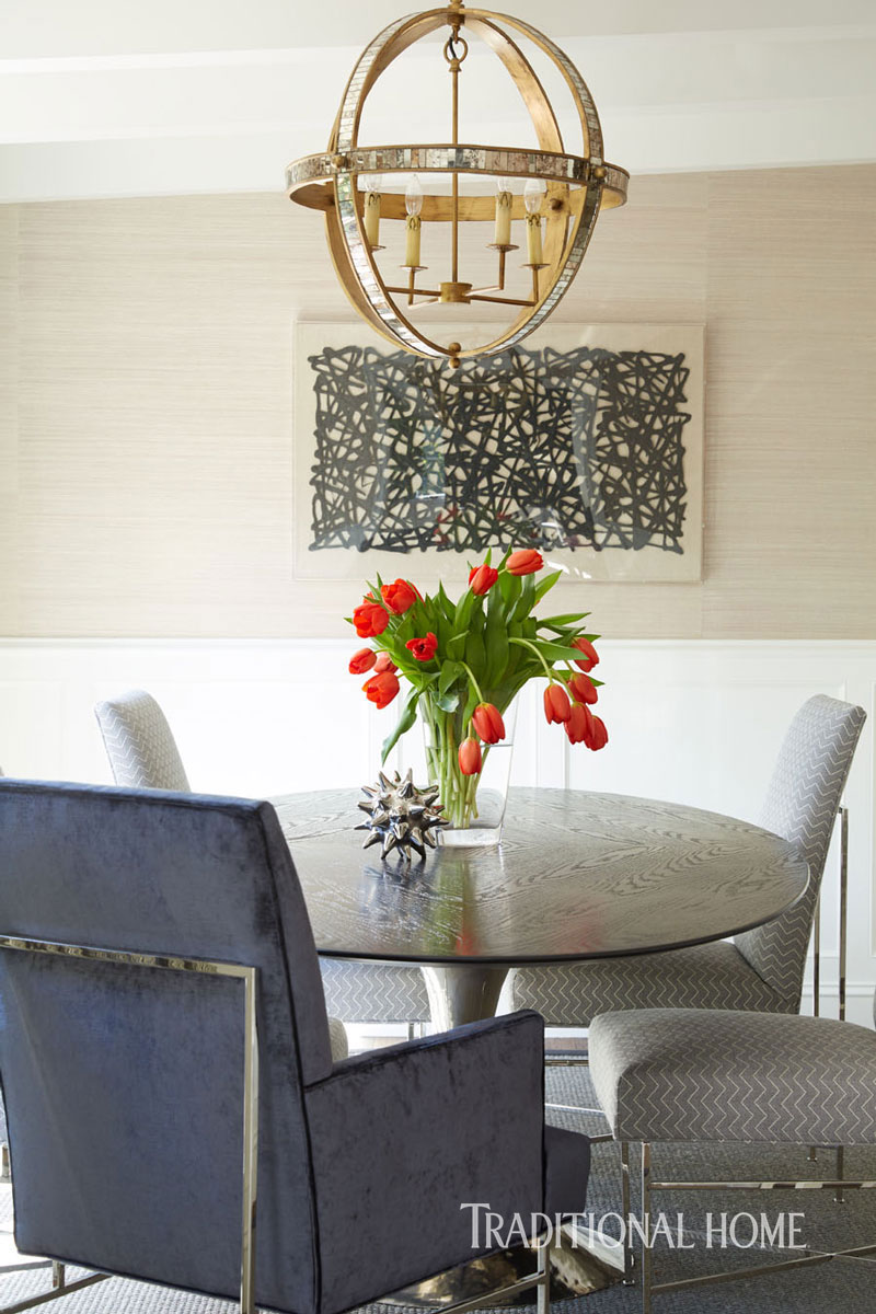 Dining room with seagrass wallpaper, modern art, and Saarinen style dining table. Traditional Home Tour Renovation by William Hefner. #traditionaldecor #diningroom #Saarinen #velvet
