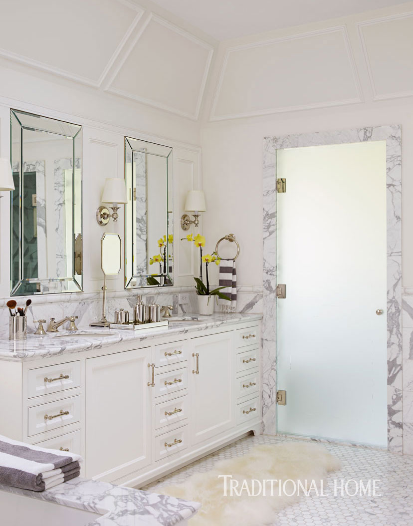Luxury bathroom with marble, chrome, and white vanity. William Hefner Traditional Home Renovation. #bathroom #whitemarble #classicaldecor