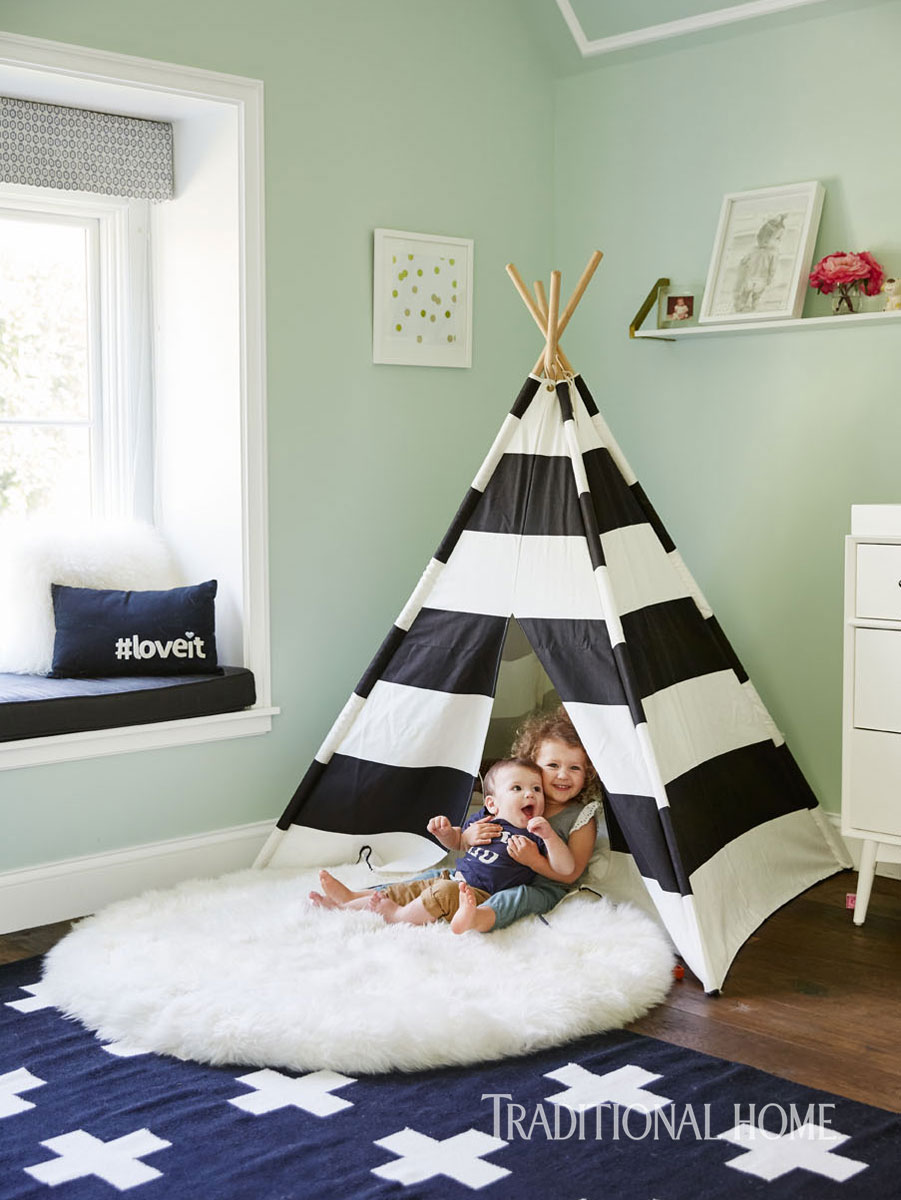 Kids room with mint green walls, black and white teepee and cross rug. William Hefner Traditional Home Renovation. #nursery #teepee #blackandwhite