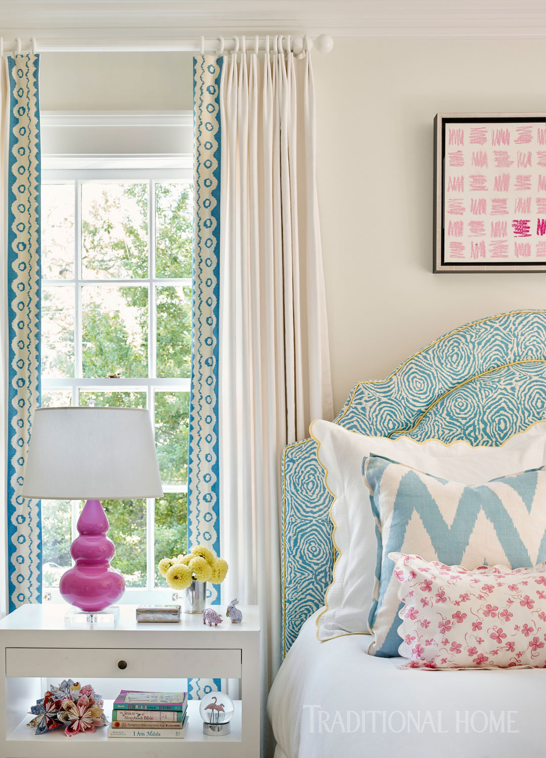 Blue, pink, and white set the pretty palette in this feminine bedroom.