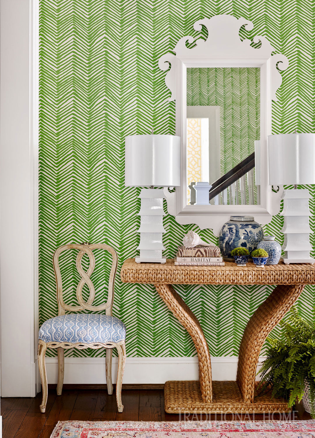 "Wallpaper, including ""Zig Zag"" from Quadrille, was used in hallways to connect the home's common spaces."