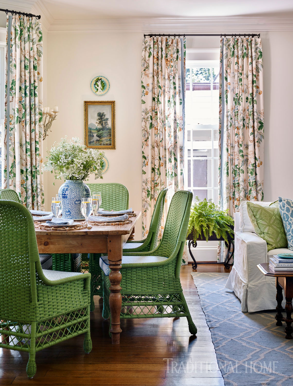 The springy palette continues in the breakfast room where verdant green dining chairs pull up to a rustic table.
