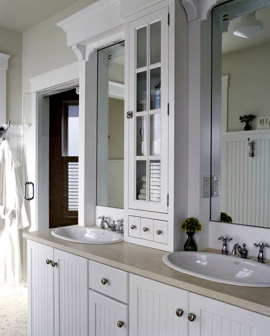 A Basic Dual Sink Vanity Is Upgraded With New Marble Top And Slender Gl Front Cabinet At Counter Level Between The Two Sinks
